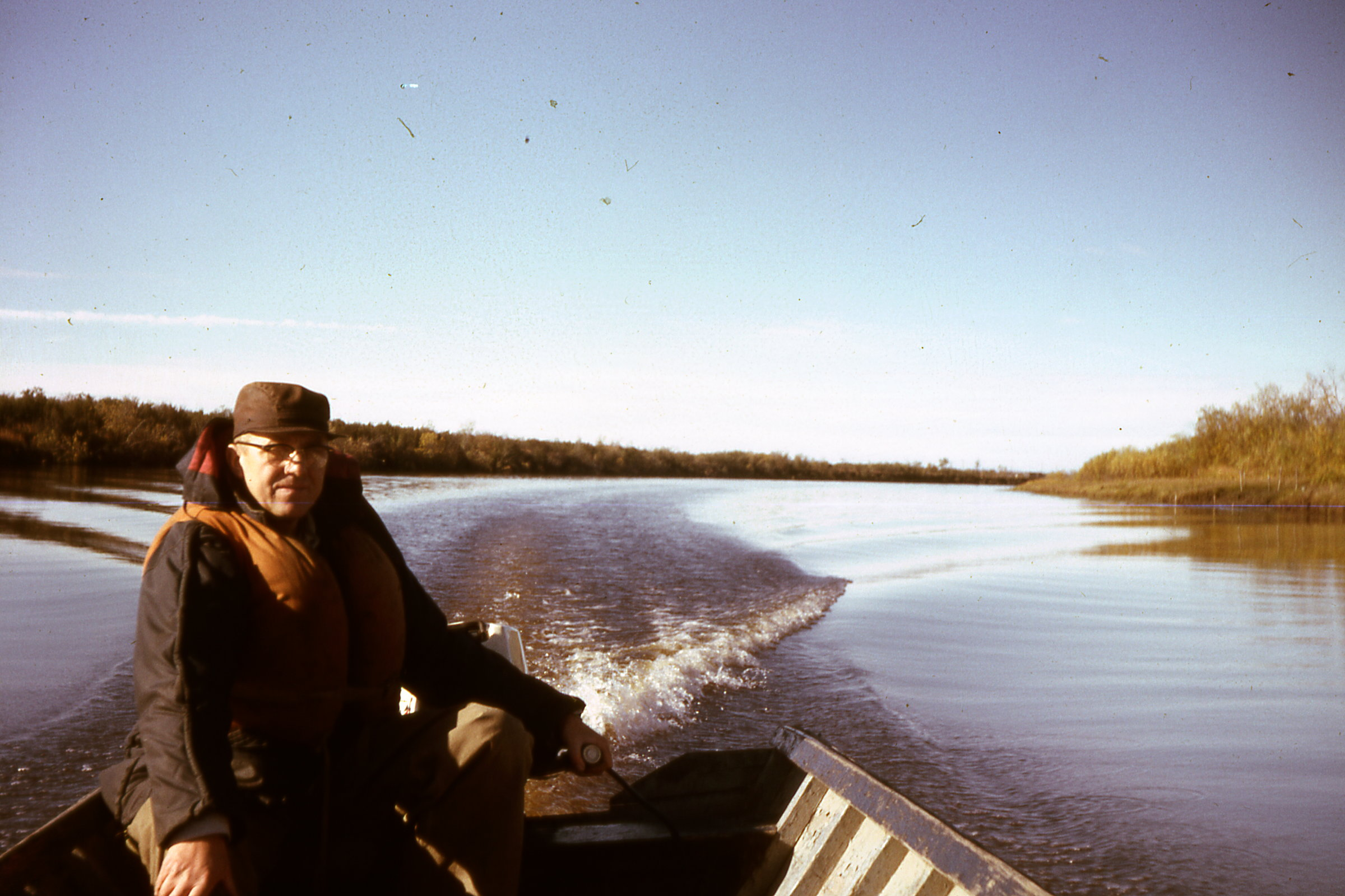 1965 Dad in Wasslies boat with our engine
